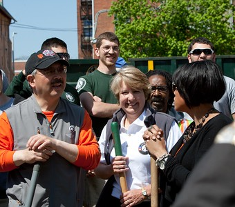 San Francisco Mayor Edwin M. Lee, CNCS CEO Wendy Spencer, Baltimore Mayor Stephanie Rawlings-Blake and AmeriCorps members chat at the Service Bowl in Baltimore, MD. Corporation for National and Community Service Photo.