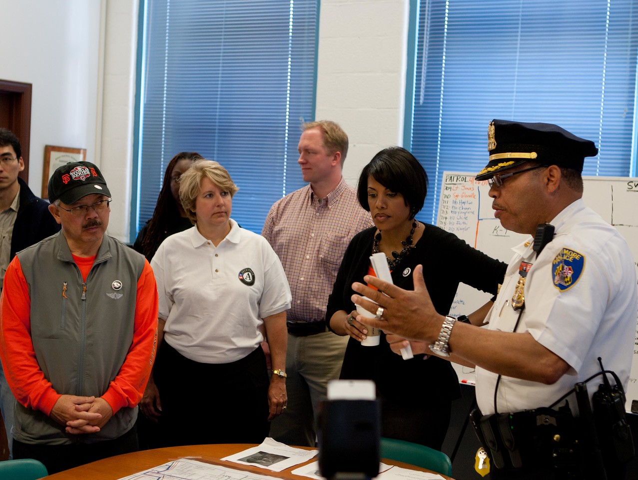 San Francisco Mayor Edwin M. Lee, CNCS CEO Wendy Spencer, and Baltimore Mayor Stephanie Rawlings-Blake with police officials at a West Baltimore Police precinct at the Service Bowl in Baltimore, MD. Corporation for National and Community Service Photo.
