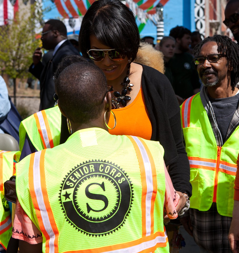 Baltimore Mayor Stephanie Rawlings-Blake meets with a Senior Corps volunteer at the Service Bowl in Baltimore, MD. Corporation for National and Community Service Photo.