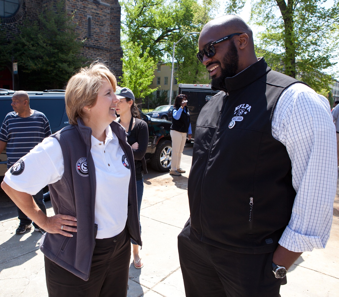 CNCS CEO Wendy Spencer chats with Joe Briggs of the NFL Players Association at the Service Bowl in Baltimore, MD. Corporation for National and Community Service Photo.