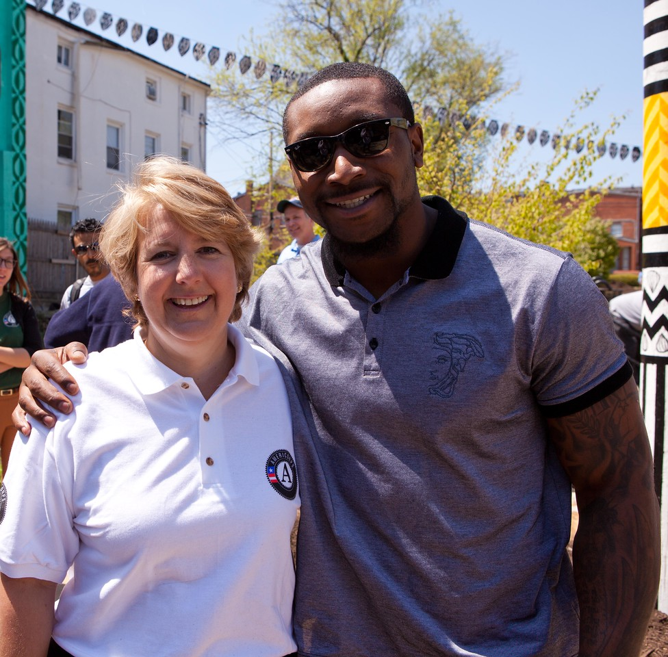 CNCS CEO Wendy Spencer poses with San Francisco 49ers linebacker Navorro Bowman at the Service Bowl in Baltimore, MD. Corporation for National and Community Service Photo.