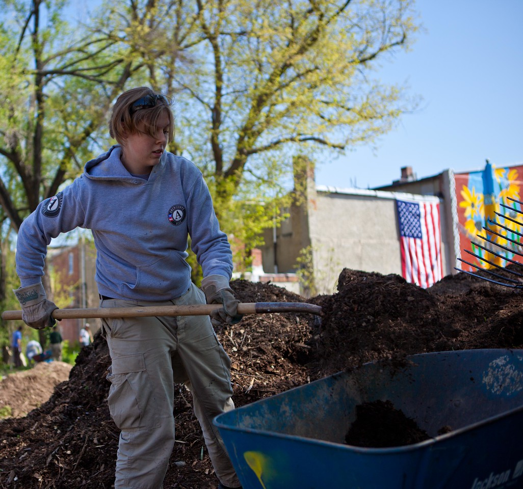 An AmeriCorps member rehabilitates a vacant lot at the Service Bowl in Baltimore, MD. Corporation for National and Community Service Photo.