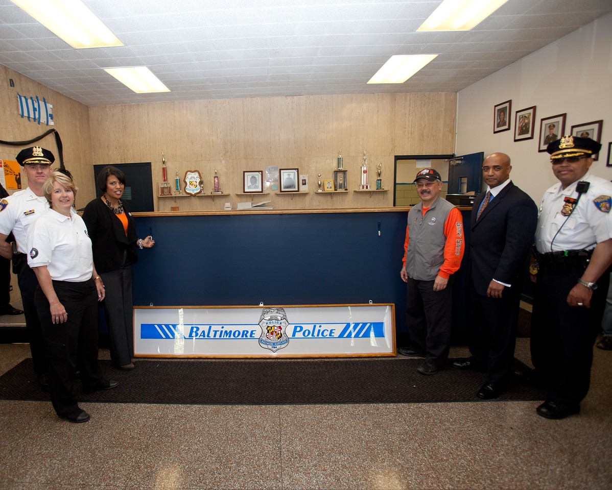 CNCS CEO Wendy Spencer, Baltimore Mayor Stephanie Rawlings-Blake, and San Francisco Mayor Edwin M. Lee with police officials at a West Baltimore Police precinct at the Service Bowl in Baltimore, MD. Corporation for National and Community Service Photo.