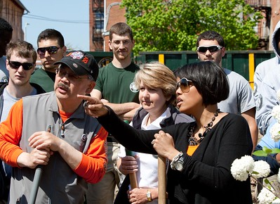 San Francisco Mayor Edwin M. Lee, CNCS CEO Wendy Spencer, Baltimore Mayor Stephanie Rawlings-Blake and AmeriCorps members survey the site at the Service Bowl in Baltimore, MD. Corporation for National and Community Service Photo.