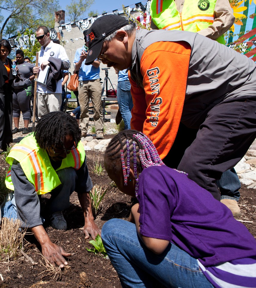 San Francisco Mayor Edwin M. Lee, Senior Corps volunteers, AmeriCorps members, and community volunteers beautify a vacant lot at the Service Bowl in Baltimore, MD. Corporation for National and Community Service Photo.