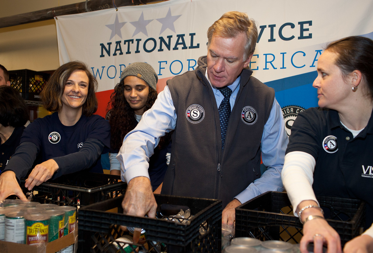 Seniors Corps member, and AmeriCorps VISTA members serve with Mayor Christopher B. Coleman, of St. Paul, Minn. with packing food containers at Pike Place Food Bank in Seattle, WA. Corporation for National and Community Service Photo.