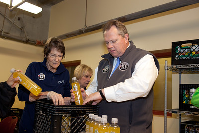 Senior Corps member and Mayor Scott Smith of Mesa, Ariz., pack food containers at the Pike Place Food Bank in Seattle, WA. Corporation for National and Community Service Photo.