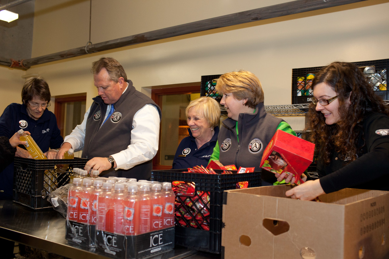 Senior Corps members, VISTA member and Mayor Scott Smith of Mesa, Ariz., and CEO, CNCS, Wendy Spencer pack food containers at the Pike Place Food Bank in Seattle, WA. Corporation for National and Community Service Photo.