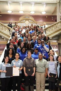 Mayor Angel Taveras (Providence, RI) alongside national service participants and holding up a proclamation - proclaiming April 1 as Mayors Day of Recognition for National Service in the City of Providence. Corporation for National and Community Service Photo.