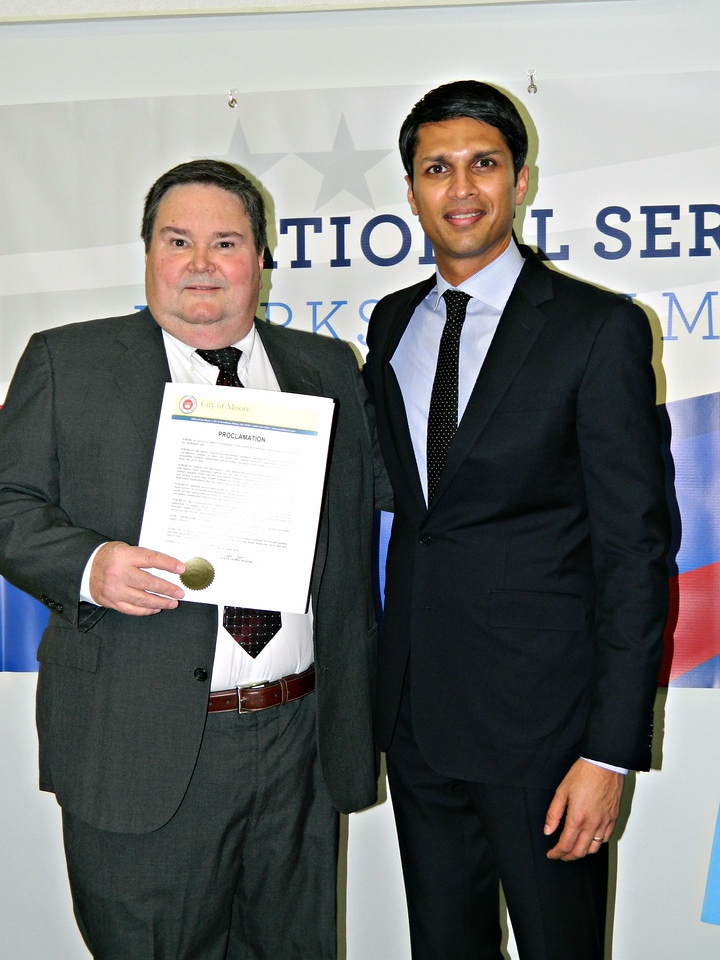 CNCS Deputy Chief of Staff Asim Mishra and Mayor Glenn Lewis participating in Mayors Day of Recognition for National Service in Moore, OK on April 1, 2014. Corporation for National and Community Service Photo.