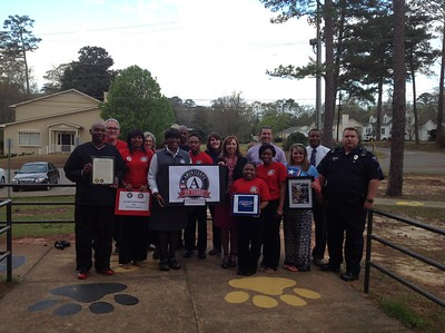 AIST members celebrating Mayor's Day of Recognition for National Service in Georgiana, Al -  Mayor Jerome Antone, Senior AmeriCorps Program Director Christine Williams (ServeAlabama), Butler County Superintendent Amy Bryan, GMS Principal Curtis Black, GMS Asst. Principal Kent McNaughton, GMS Officer Vann and AIST Program Director Carol McArthur (AIST members: Jerry Stephens, Deirdre Parker-Jackson,  Patrick Davidson, Bonita Thomas, Preston Thomas, Mallory Schofield, La'Shunda Clayton, Patrice Parmer; Kairee Newton). Corporation for National and Community Service Photo.