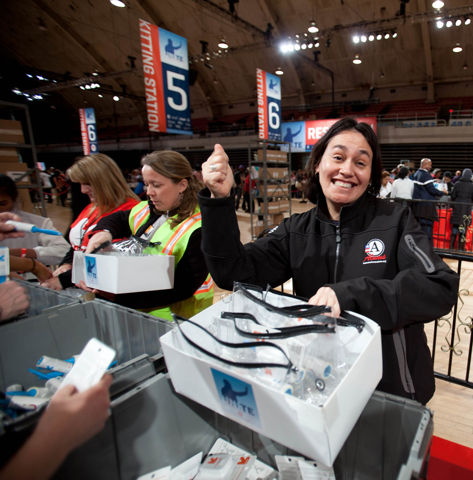 An AmeriCorps member starts packing care kits during the National Day of Service and MLK Day of Service event at the D.C. Armory on Jan. 19, 2013. (Corporation for National and Community Service Photo)