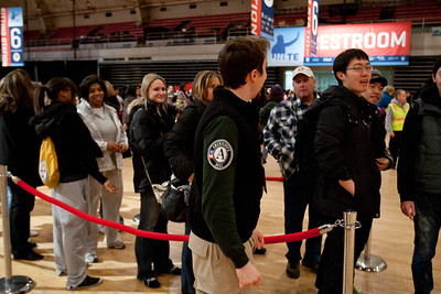 AmeriCorps member coordinating volunteer lines at the DC Armory - National Day of Service - MLK Day 2013. Corporation for National and Community Service Photo.