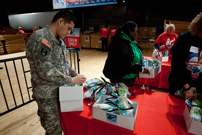 A U.S. serviceman helps pack care packages during the National Day of Service and MLK Day   of Service event at the D.C. Armory on Jan. 19, 2013. (Corporation for National and Community Service Photo)