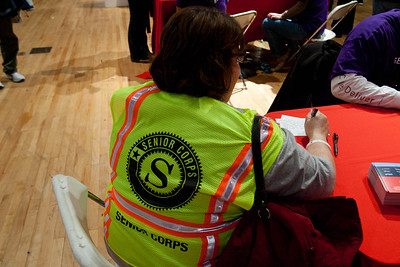 Senior Corps member writing a letter to troops stationed abroad at the DC Armory - National Day of Service - MLK Day 2013. Corporation for National and Community Service Photo.