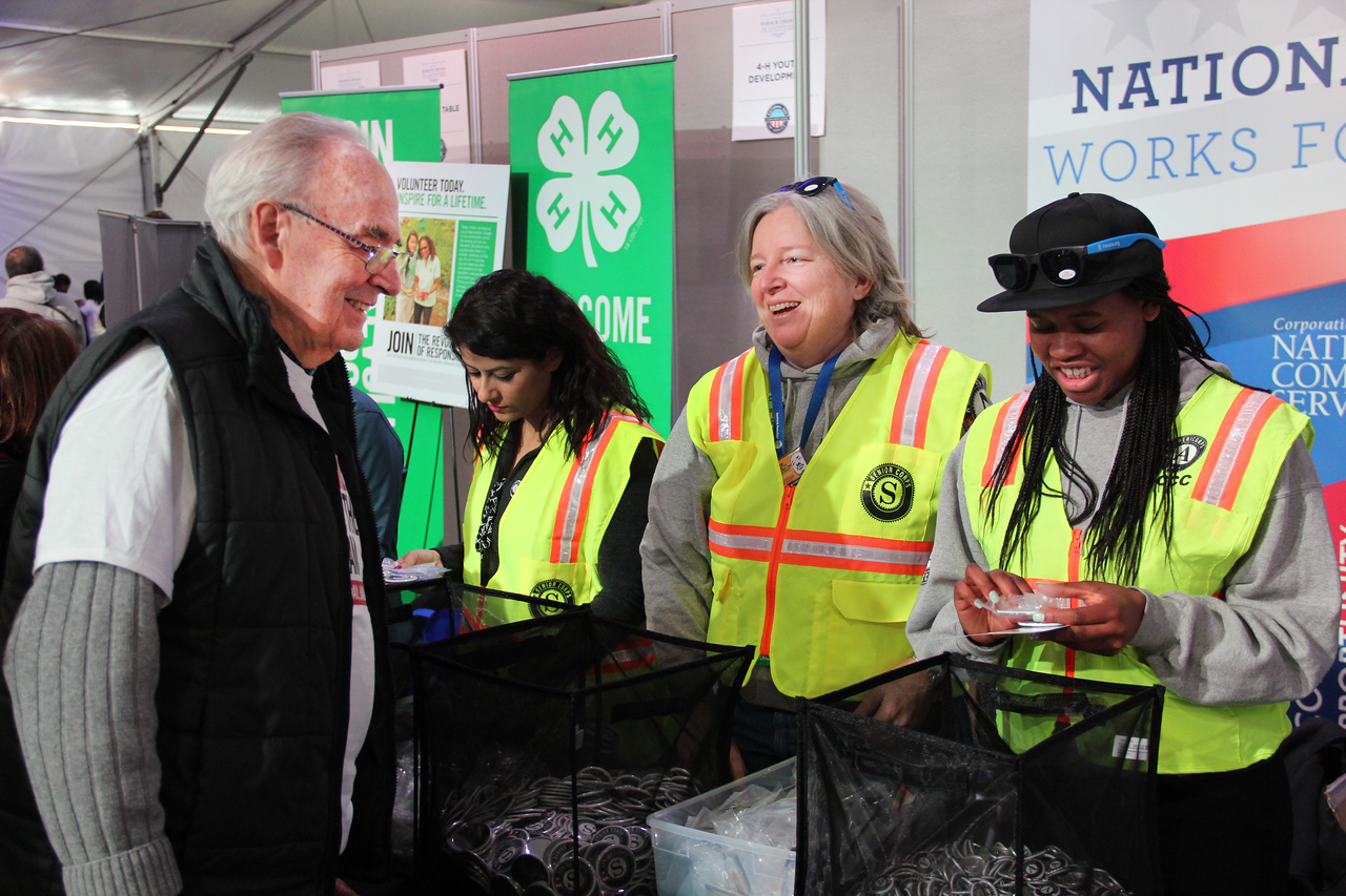 Sen. Harris Wofford meets national service participants during the Service Fair at the National Mall in Washington, DC, on Jan. 19, 2013. (Corporation for National and Community Service photo)