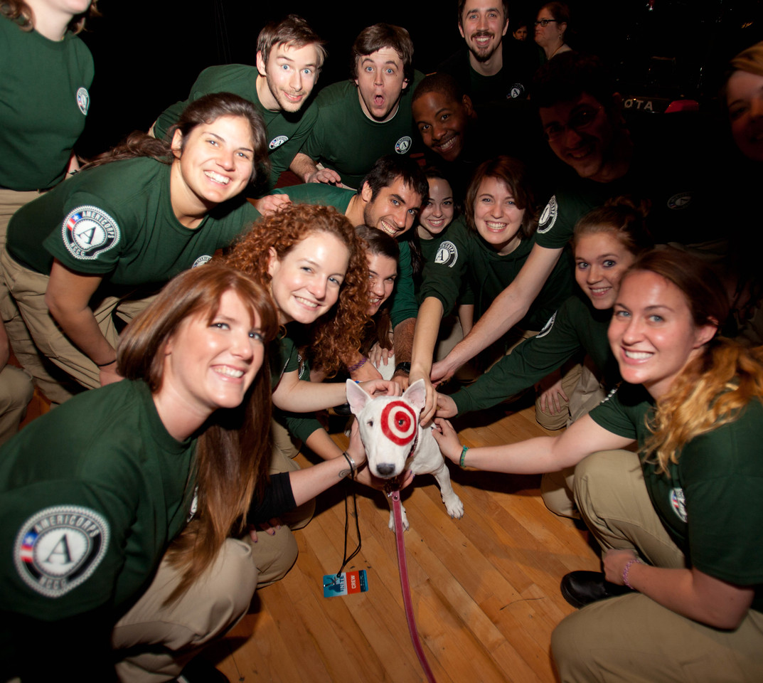 """Members of AmeriCorps NCCC pose with """"Bullseye."""" DC Armory - National Day of Service - MLK Day 2013.Corporation for National and Community Service Photo."""
