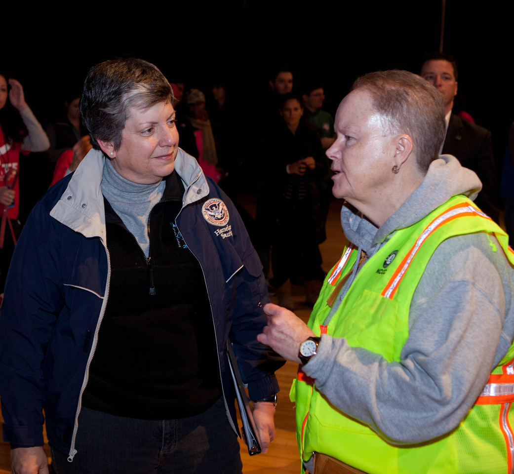 AmeriCorps NCCC Director Kate Raftery speaks with Secretary of Homeland Security Janet Napolitano. DC Armory - National Day of Service - MLK Day 2013.Corporation for National and Community Service Photo.