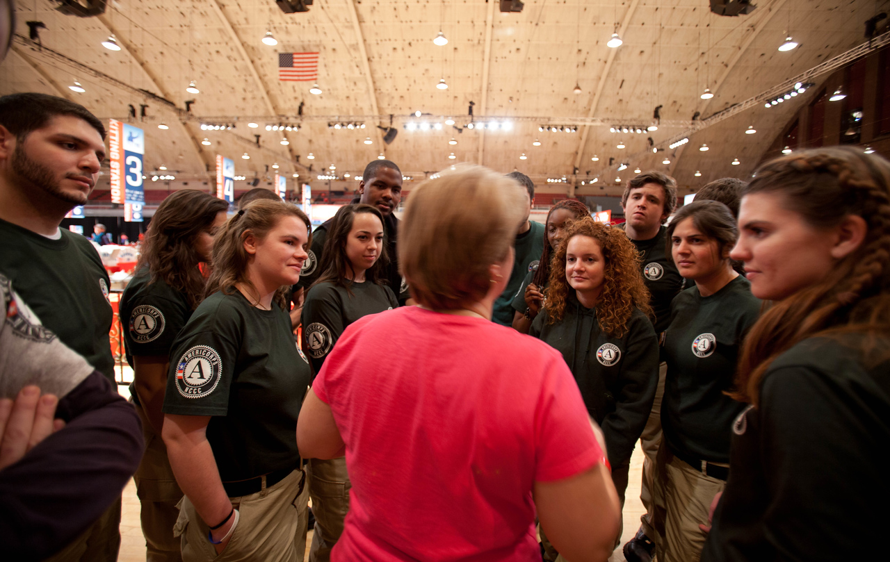 CNCS CEO Wendy Spencer talks to members of AmeriCorps NCCC. DC Armory - National Day of Service - MLK Day 2013.Corporation for National and Community Service Photo.