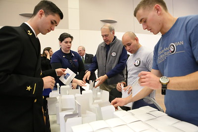 AmeriCorps Director Bill Basl and CNCS Veterans and Military Families fellow John Lira serving at a George Washington University sponsored Veterans Day service project packing care packages for service men and women abroad. Corporation for National and Community Service Photo.