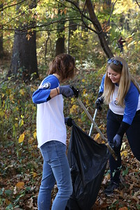 AmeriCorps members from Arlington Works, Amy Gale and Rachel LaCroix picking up litter at an SCA sponsored service project in Washington, D.C. Corporation for National and Community Service Photo.