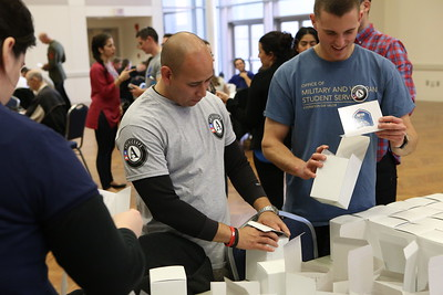 CNCS Veterans and Military Families fellow John Lira serving at George Washington University sponsored Veterans Day service project packing care packages for service men and women abroad. Corporation for National and Community Service Photo.