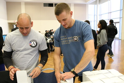CNCS Veterans and Military Families fellow John Lira George Washington University sponsored Veterans Day service project packing care packages for service men and women abroad. Corporation for National and Community Service Photo.