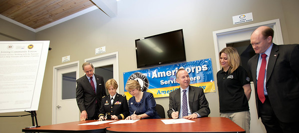 Signing of the MOU. Sen. Tom Carper (DE), Brig. Gen. Marianne E. Watson, National Guard Bureau Director of Manpower and Personnel, CNCS, CEO, Wendy Spencer, Gov. Jack Markell (DE), VISTA member and Sen. Chris Coons (DE). Corporation for National and Community Service Photo.Corporation for National and Community Service Photo.