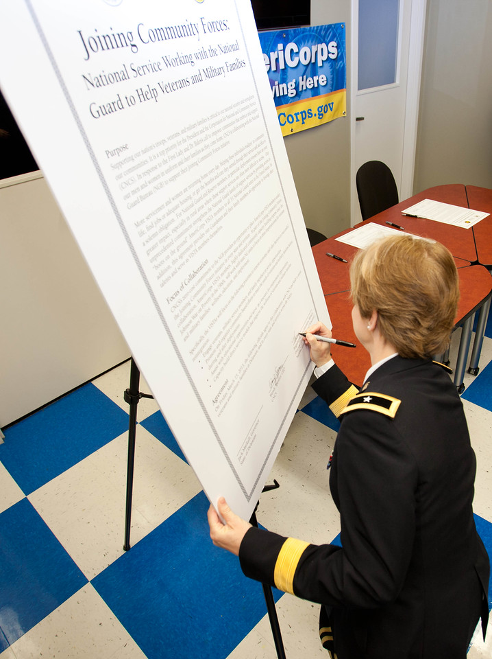 Brig. Gen. Marianne E. Watson, National Guard Bureau Director of Manpower and Personnel signing the Joining Forces MOU in Wilmington, DE. Corporation for National and Community Service Photo.