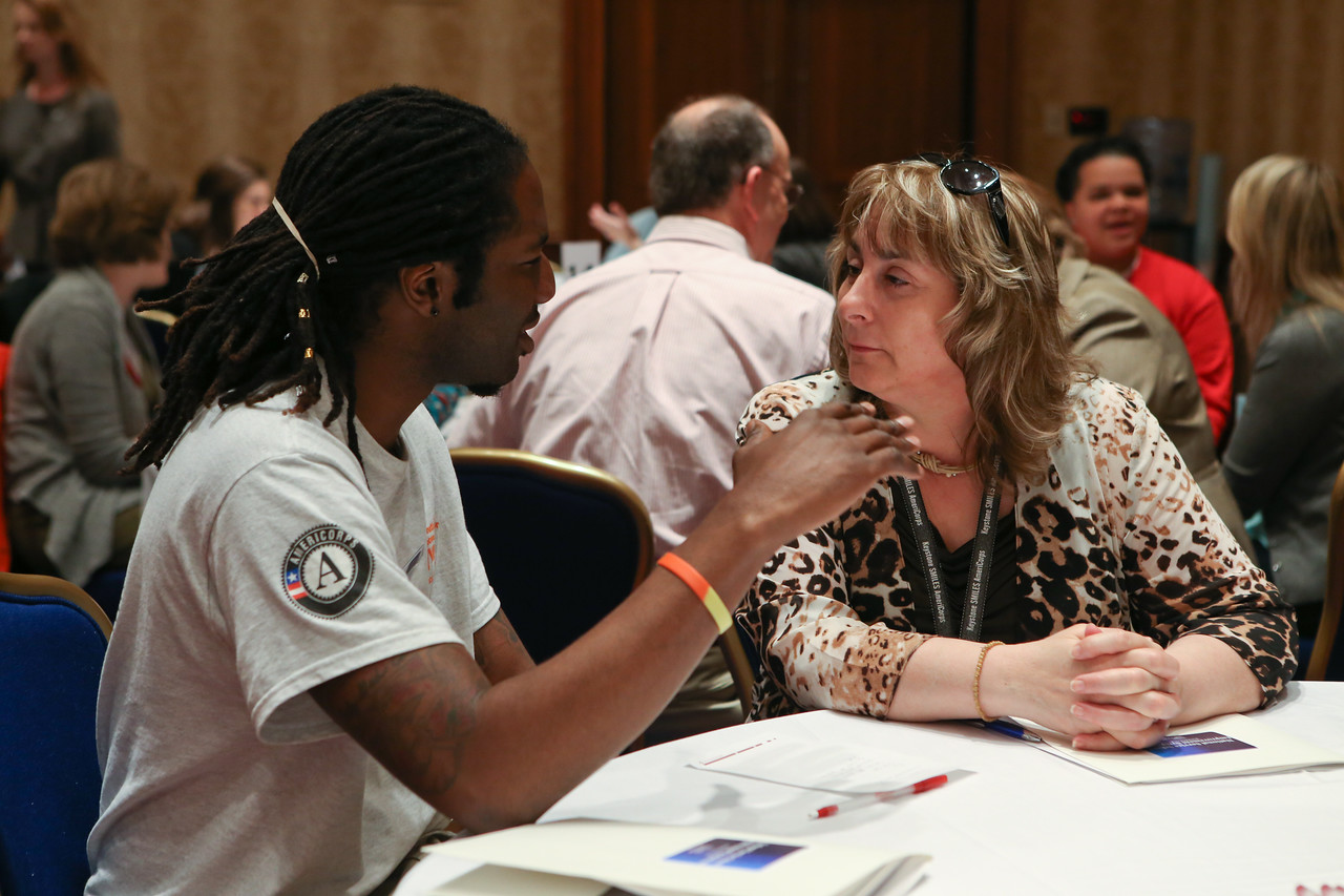 AmeriCorps member has a discussion during the Education Symposium. Corporation for National and Community Service Photo.