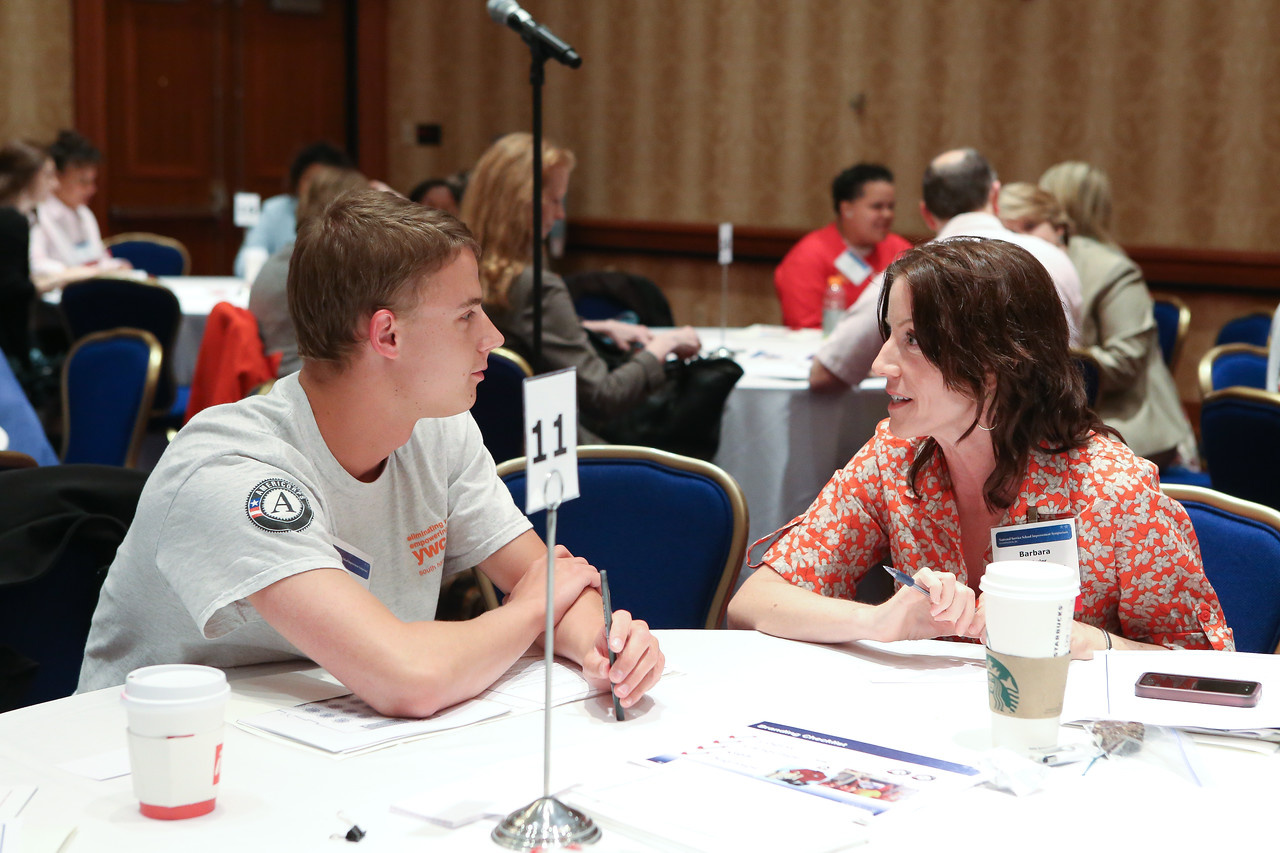 AmeriCorps member has a discussion during the Education Symposium.Corporation for National and Community Service Photo.