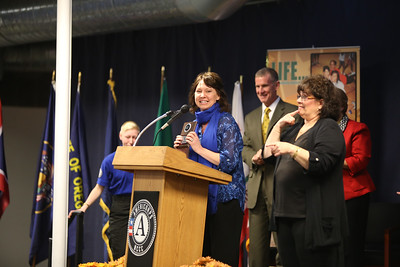 FEMA Corps parent, and team leader receives an award at the FEMA Corps graduation. Corporation for National and Community Service Photo.
