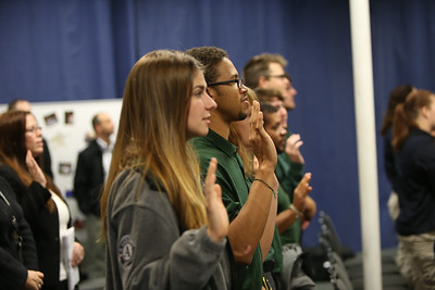 FEMA Corps members reciting the AmeriCorps pledge at their graduation. Corporation for National and Community Service Photo.