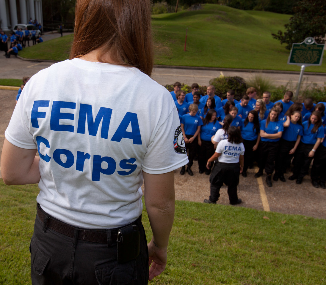 A FEMA Corps team leader organizes a team photo before induction. Corporation for National and Community Service Photo.