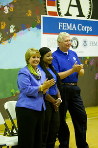CNCS CEO, Wendy Spencer, FEMA Corps member, Donisha Brown and FEMA Deputy Administrator, Richard Serino applaud as inductees fill the auditorium. Corporation for National and Community Service Photo.