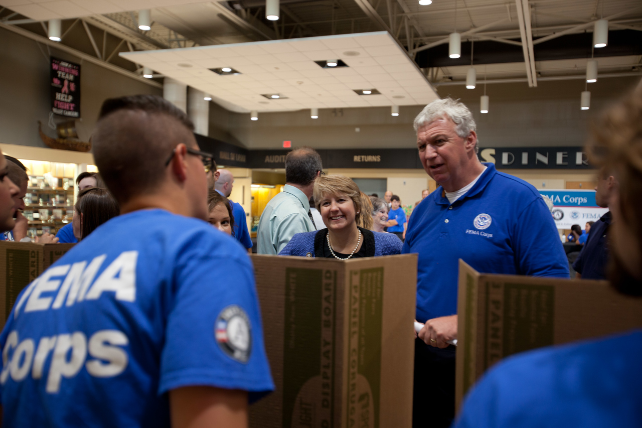 (L-R) CNCS CEO, Wendy Spencer and FEMA Deputy Administrator, Rich Serino speak with FEMA Corps members before induction. Corporation for National and Community Service Photo.