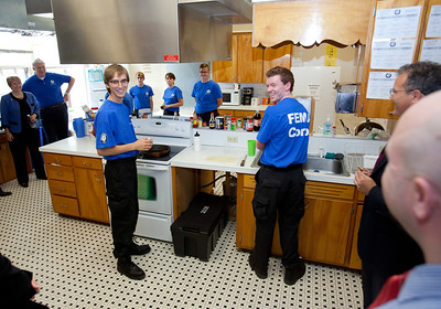 FEMA Corps members prepare dinner before induction, as CNCS and FEMA leadership take a tour of the campus. Corporation for National and Community Service Photo.