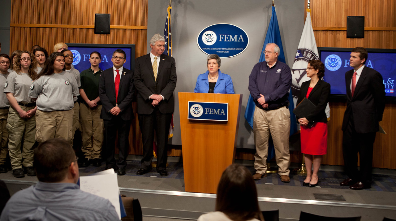 Janet Napolitano, Secretary of Homeland Security (speaking), Left to Right, AmeriCorps NCCC members, Robert Velsaco II, Acting CEO, Corporation for National and Community Service, Richard Serino, Deputy Administrator, FEMA, Craig Fugate, Administrator, FEMA, Cecilia Munoz, Director of the White House Domestic Policy Council, Walter Maddox, Mayor of Tuscaloosa. Corporation for National and Community Service Photo