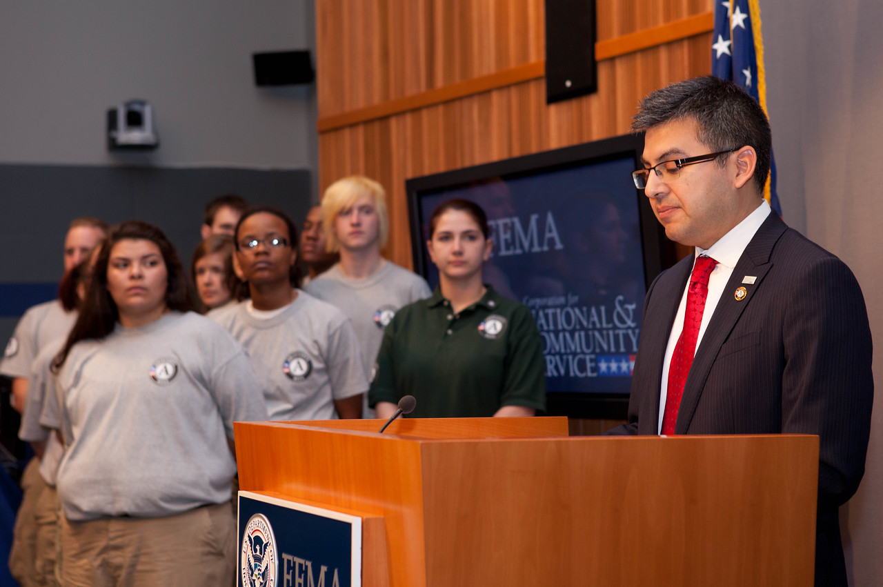 Robert Velsaco II, Acting CEO, Corporation for National and Community Service (speaking), left - AmeriCorps NCCC members.    Corporation for National and Community Service Photo.