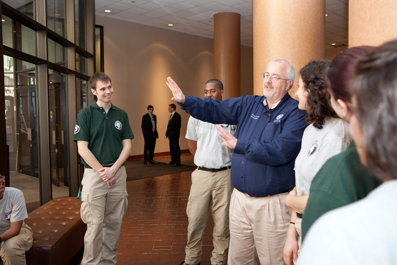 Craig Fugate, Administrator, FEMA (center), AmeriCorps NCCC members. Corporation for National and Community Service Photo.