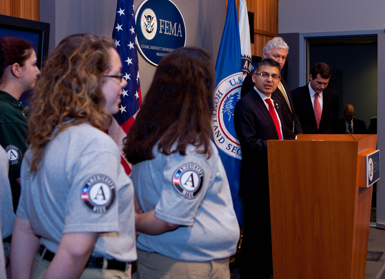 Robert Velsaco II, Acting CEO, Corporation for National and Community Service (speaking), left to right, AmeriCorps NCCC members, Richard Serino, Deputy Administrator, FEMA, Walter Maddox, Mayor of Tuscaloosa.   Corporation for National and Community Service Photo.