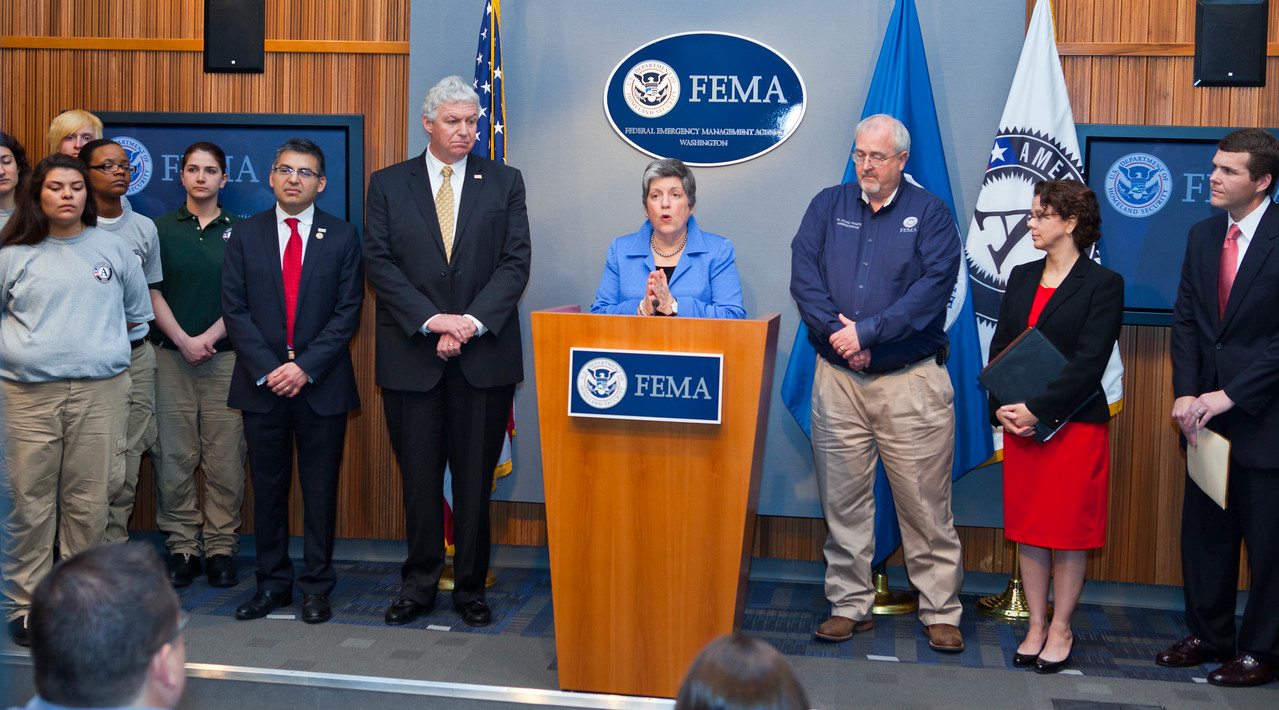 Janet Napolitano, Secretary of Homeland Security (speaking), left to right - AmeriCorps NCCC members, Robert Velsaco II, Acting CEO, Corporation for National and Community Service, Richard Serino, Deputy Administrator, FEMA, Craig Fugate, Administrator, FEMA,  Cecilia Munoz, Director of the White House Domestic Policy Council, Walter Maddox, Mayor of Tuscaloosa.   Corporation for National and Community Service Photo.