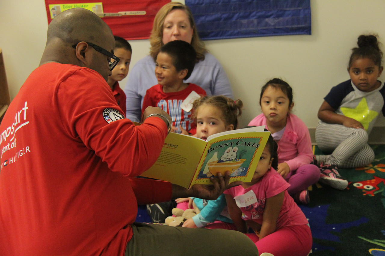 An AmeriCorps member reading to students at Jumpstart's ninth annual Read for the Record campaign at the Barbara Chamber Children's Center in Washington, D.C. Corporation for National and Community Service Photo.