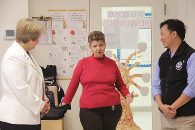 Barbara Chamber Children's Center Administrator speaks with CNCS CEO Wendy Spencer and Director of Senior Corps Erwin Tan. Corporation for National and Community Service Photo.