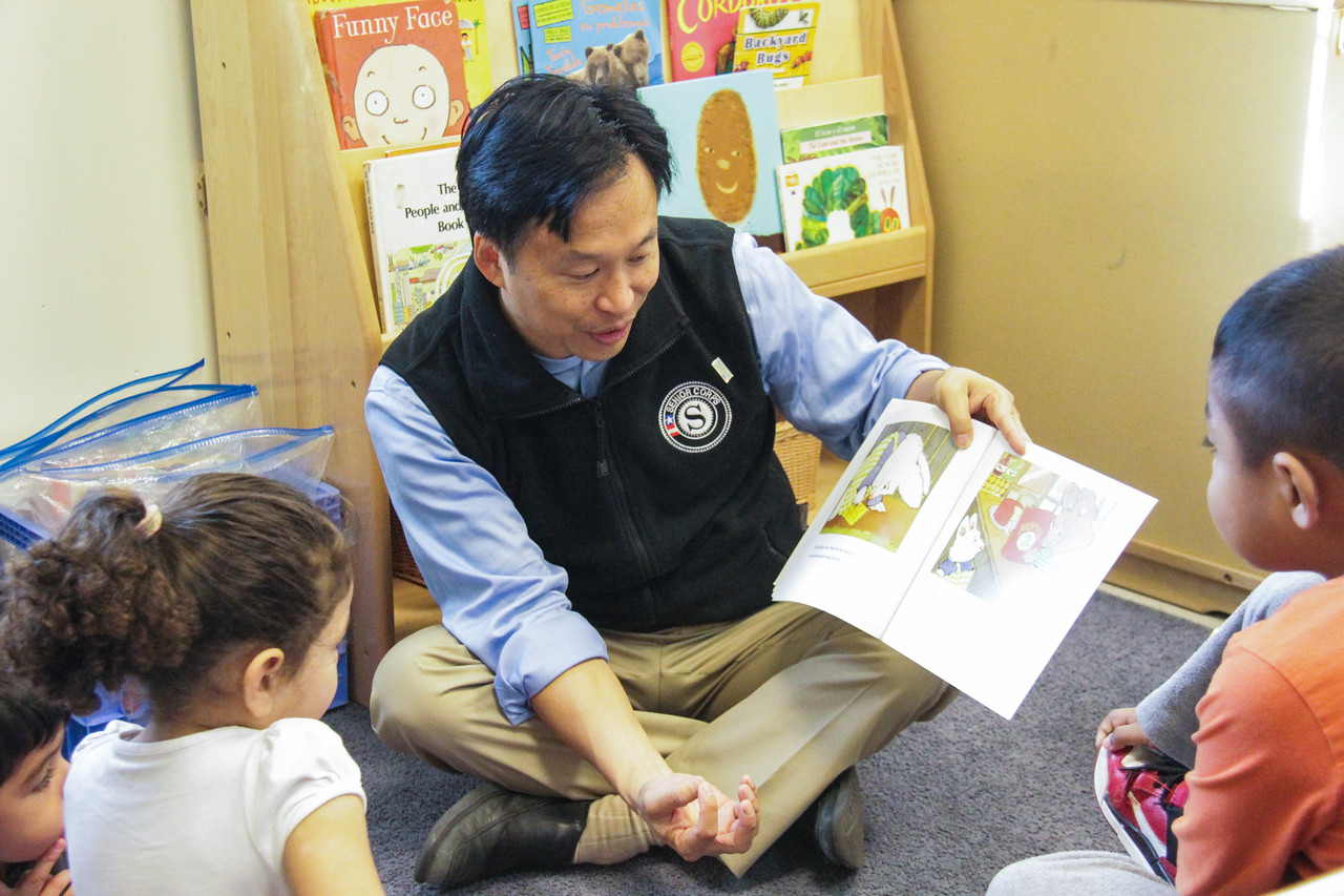 Director of Senior Corps Erwin Tan reading to students at Jumpstart's ninth annual Read for the Record campaign at the Barbara Chamber Children's Center in Washington, D.C. Corporation for National and Community Service Photo.