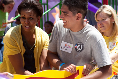 (L-R) First Lady Michelle Obama, AmeriCorps volunteer, On Wednesday, the Corporation for National and Community Service joined First Lady Michelle Obama, U.S. Secretary of Education Arne Duncan, Members of Congress and their spouses, along with AmeriCorps members and over 150 volunteers for the annual Congressional Day of Service event at a KaBOOM! event. Corporation for National and Community Service Photo.