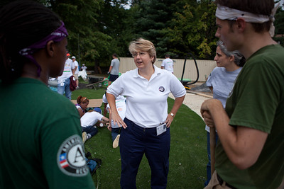 NCCC members and Corporation for National and Community Service CEO, Wendy Spencer talk at the KaBOOM build at NIH. Corporation for National and Community Service Photo