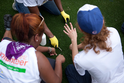 Volunteers lay down turf for the playground at the NIH KaBOOM! build. Corporation for National and Community Service Photo.