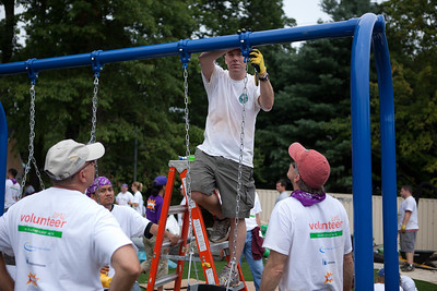 Volunteers install swings for the playground at the NIH KaBOOM! build. Corporation for National and Community Service Photo.