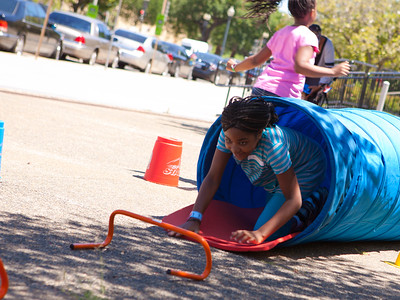 Children participating in an obstacle course at The Department of Education event for Let's Read. Let's Move. Corporation for National and Community Service Photo.